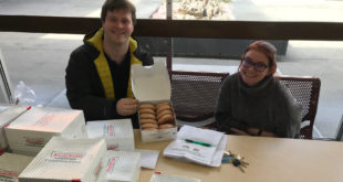 Haven Thompson and Michael Clarke sell donuts for PRSSA.